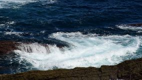 Waves flooding rocks stock video footage
