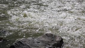 Rock and flowing water stock video footage