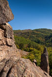 Rock and forest. View from the rocks to the top of the mountain Royalty Free Stock Photography