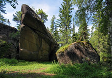 Rock in the forest at reserve Krasnoyarsk pillars Royalty Free Stock Photo