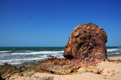 Rock formation. Coastal view with red rock formation on seashore Royalty Free Stock Images