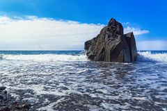 Rock formation at the beach against blue sky. Praia Formosa beach, Funchal, Portuguese island of Madeira stock photo