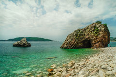 Rock formation on beach at Rafailovici Stock Image