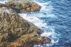 Rock Formation on Blue Ocean Waater Stock Photos