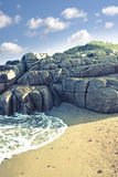 Rock formation on a coastal beach in county Donegal Stock Images
