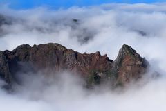 Rock formation in dense clouds on Pico do Arieiro. Madeira island. Rock formation in dense clouds on Pico do Arieiro on Portuguese island of Madeira royalty free stock photos