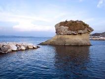 A rock formation in Lacco Ameno. Photo of Il Fungo, a rock just off shoreline of Lacco Ameno, Ischia, Italy Royalty Free Stock Images