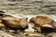 Rock formation in the middle of the sea water Royalty Free Stock Photo