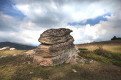 A rock formation on a mountain Royalty Free Stock Images