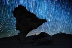 Rock formation named Arbol de Piedra. At night with starry sky on the background. Bolivia Stock Photo