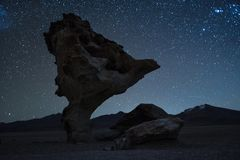 Rock formation named Arbol de Piedra. Stone Tree with starry sky on the background. Bolivia. Image has some noise due to high ISO Stock Photos