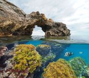 Free Rock Formation Natural Arch With Algae And Fish Underwater Stock Photos - 131683503