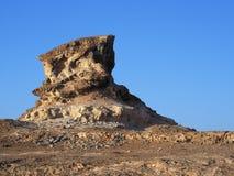 Rock formation near Shuwaymiyah. Rock formation near a fishing village Shuwaymiyah, Dhofar region, Sultanate of Oman Royalty Free Stock Image