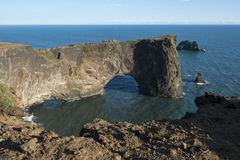 Rock formation in the ocean, Dyrholaey rock arch, South Iceland Royalty Free Stock Photography