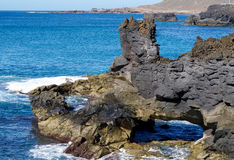 Rock formation in the ocean Stock Image