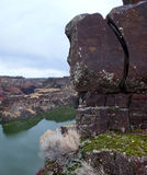 Rock Formation Over Snake River. Large lava rock formation perched on the rim of the Snake River Canyon in Idaho Royalty Free Stock Photos