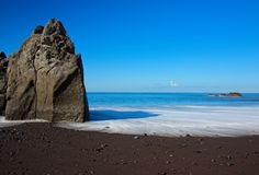 Black sand beach Praia Formosa on Portuguese island of Madeira. Rock formation on Praia Formosa beach - famous public black sand beach on Portuguese island of stock photos