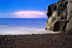Rock formation on Praia Formosa beach on Portuguese island of Madeira. Rock formation on Praia Formosa beach - famous public black sand beach on Portuguese stock image