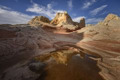 Rock Formation and reflection at sunrise, White Pocket, Arizona royalty free stock images