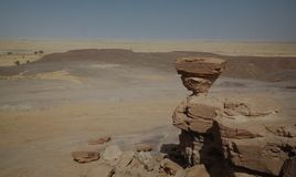 Rock formation at Sahara desert near Tchirozerine region, Agadez, Niger. Rock formation at Sahara desert near Tchirozerine region near Agadez, Niger Stock Image