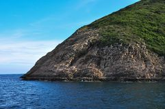 Rock formation in Sai Kung, Hong Kong. Volcanic rock formations in Sai Kung, Hong Kong taken from a ship royalty free stock photo