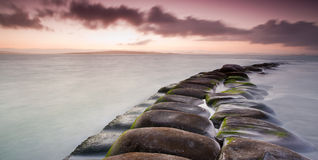 Rock formation in sea stock image