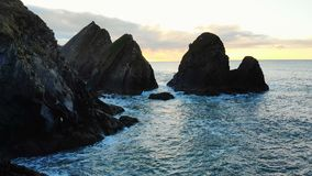 Rock formation in sea at dusk 4k. Beautiful rock formation in sea at dusk 4k stock video footage