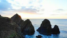 Rock formation in sea at dusk 4k. Beautiful rock formation in sea at dusk 4k stock footage