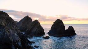 Rock formation in sea at dusk 4k. Beautiful rock formation in sea at dusk 4k stock video