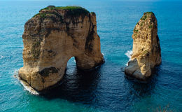 Rock formation in the sea - Pigeons Rock / Sabah Nassar`s Rock / Raouche in Beirut, Lebanon royalty free stock image