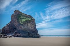 Bedruthan Steps rock formations Cornwall England. Rock formations on a beach in a low tide on a sunny summer day Stock Photo