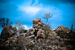 Rock formations and blue sky. Artistic illustration of rock formations with blue sky background Royalty Free Stock Images