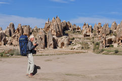 Rock formations of Cappadocia and photographer Stock Images