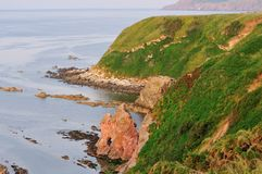Rock formations caused by the North Sea. Coastline and rock formations on the North East coast of Scotland Stock Photo