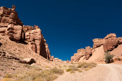 Rock formations at Charyn canyon under blue sky Royalty Free Stock Photo