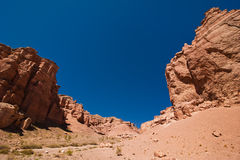 Rock formations at Charyn canyon under blue sky Stock Photo