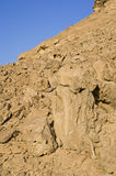 Rock formations in the desert. Rock formations on the side of a mountain slope in the desert Royalty Free Stock Photo
