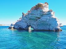 Rock formations off the coast of Polyaigos, an island of the Greek Cyclades. Rock formations emerge from the crystal blue sea off Polyaigos near the island of royalty free stock photos