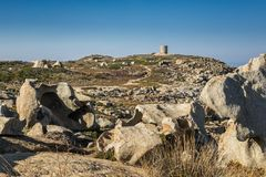 Rock formations and Genoese tower at Punta Spano in Corsica. Unusual rock formations by a Genoese tower at Punta Spano on the coast of the Balagne region of stock photos