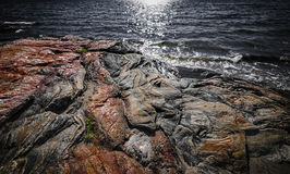 Rock formations at Georgian Bay. Exposed bedrock and colorful rock formations at rugged Georgian Bay lake shore near Parry Sound, Ontario, Canada Stock Image