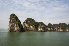Rock formations in Halong Bay. Rock formations and the seascape in Halong Bay, Vietnam Royalty Free Stock Photos