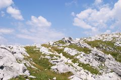 Rock formations on hillside Royalty Free Stock Photo