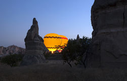 Rock formations and hot air balloons at Cappadocia Turkey Stock Image