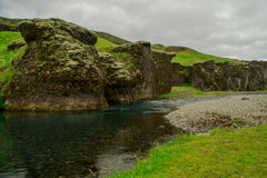 Rock formations in Icelandic Canyon. ROck formations and river near Fjadrargljufur Canyons, Iceland Royalty Free Stock Image