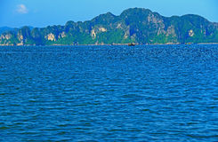 Rock formations and islands from ha long bay beach Vietnam Stock Photography