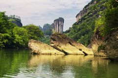 Wuyishan nine bend river china. Rock formations lining the nine bend river or Jiuxi in Wuyishan or Mount wuyi scenic area in Wuyi China in fujian province royalty free stock photography