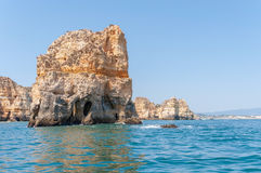 Rock formations near Lagos seen from the water Stock Photo