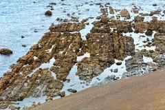 Rock formations near shore. Summer Atlantic ocean Biscay bay coast with rock formations near shore Stock Photography