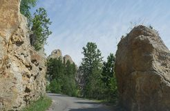 Rock formations at Needle\'s Eye, Needle\'s Highway, South Dakota. Granite boulders and dramatic rock formations border the winding road along Needles Highway in royalty free stock photos