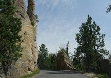 Rock formations at Needle\'s Eye, Needle\'s Highway, South Dakota. Winding road snaking around incredible rock formations along Needles Highway in South Dakota stock photos